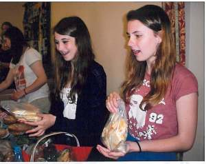 Young people selling cakes to raise funds for Connect2 El Slavador