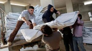 Syria-refugees-in-Lebanon-receiving-blankets-from-Caritas-Lebanon_layout-large